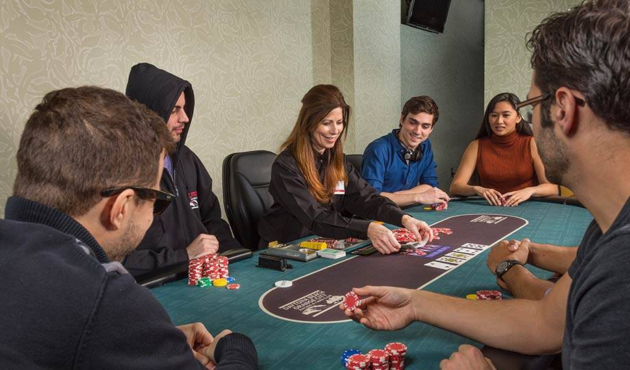 Poker players around table, Poker Tournaments, Daytona Beach Racing & Card Club